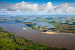 Landscape with great river under clouds Stock Photos
