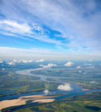 Landscape with great river under clouds Royalty Free Stock Photo