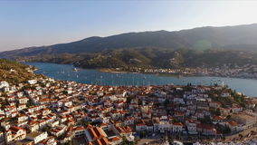 Landscape Greek island of Poros amidst the Mediterranean, with a bird`s-eye view, aerial video shooting, many moored to stock footage