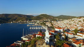 Landscape Greek island of Poros amidst the Mediterranean, with a bird`s-eye view, aerial video shooting, many moored to stock video footage