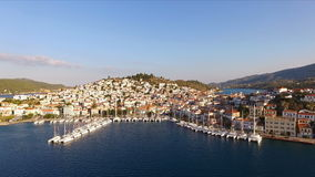 Landscape of the Greek island Poros among the Mediterranean Sea, bird`s eye view, aerial video shooting, many yachts stock video footage