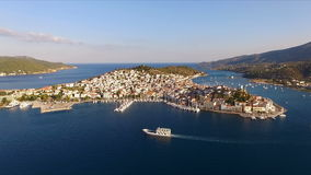Landscape of the Greek island Poros among the Mediterranean Sea, bird`s eye view, aerial video shooting, many yachts stock footage
