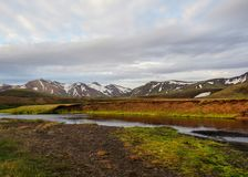 Beautiful view on Alftavatn campsite area with river, mountains and cloudy sky, Highland of Iceland, Europe. Landscape of green Alftavatn area with river and stock images