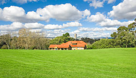 Landscape of a green golf field Stock Photos