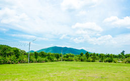 Landscape of green meadow with blue sky and mountain at country Royalty Free Stock Photo