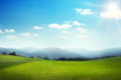 Landscape of green meadow with hills Royalty Free Stock Photography