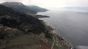 Landscape of green mountain view from helicopter on coastline of Antarctica. Scenic peaks and ridges. Beautiful background of amazing nature. Travel and stock video footage