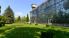 Landscape with greenhouse and water tower in the botanical garden of Cluj. Royalty Free Stock Image