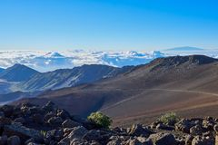 Landscape of the Haleakalā mountains higher than the clouds in Hawaii royalty free stock image