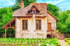 Landscape of hamlet Queen Marie Antoinette`s estate near Versai. VERSAILEES, FRANCE- JULY 02, 2016 : Landscape of hamlet Queen Marie Antoinette`s estate near Royalty Free Stock Photos