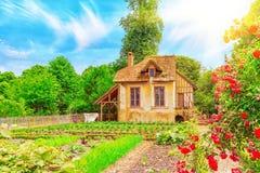 Landscape of hamlet Queen Marie Antoinette`s estate. VERSAILLES, FRANCE- JULY 02, 2016 : Landscape of hamlet Queen Marie Antoinette`s estate near Versailles Royalty Free Stock Image