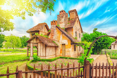 Landscape of hamlet Queen Marie Antoinette`s estate. VERSAILLES, FRANCE- JULY 02, 2016 : Landscape of hamlet Queen Marie Antoinette`s estate near Versailles Stock Image