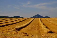Landscape after harvest. In the background of the Czech Central Mountains Royalty Free Stock Images