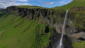 Landscape of the Hauifoss waterfall and rocks with greenery. Andreev. stock video