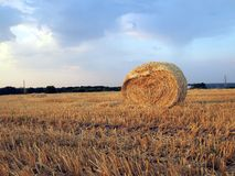 Landscape with hay roll Royalty Free Stock Photography