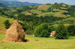 Landscape with haystack and house Royalty Free Stock Photography
