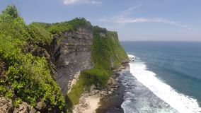 Landscape of high cliff, Bali, Indonesia. Scenic landscape of high cliff at Uluwatu Temple, Bali, Indonesia stock footage