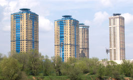 Landscape with high modern apartment buildings stock photos