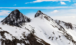 Landscape with high mountain peaks. Covered with snow Stock Image