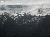 A landscape of high mountains at the end of the winter stock photography