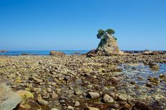 Landscape of the high tides of the minokake-rocks at izu. Tombolo phenomenon of minokake rocks at izu royalty free stock image