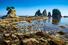 Landscape of the high tides of the minokake-rocks at izu. Tombolo phenomenon of minokake rocks at izu stock photography