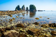 Landscape of the high tides of the minokake-rocks at izu. Tombolo phenomenon of minokake rocks at izu royalty free stock photo
