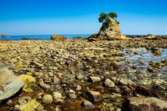 Landscape of the high tides of the minokake-rocks at izu. Tombolo phenomenon of minokake rocks at izu stock images