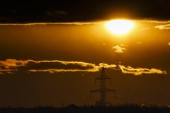Landscape with high-voltage poles. At sunset Royalty Free Stock Photos