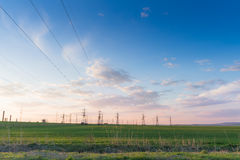 Landscape with high-voltage power lines. Electricity distributio Royalty Free Stock Image