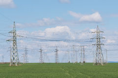 Landscape with high-voltage power lines. Electricity distributio Royalty Free Stock Photo