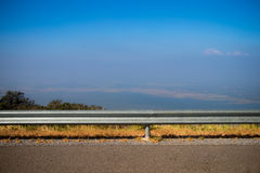Landscape of highway. And gard rail, Behide is beautiful mountain view and blue sky. viewpoint from wayside, scenery concept. travel on holidays stock photography