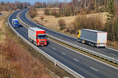 Landscape with highway, the highway ride three trucks Royalty Free Stock Image