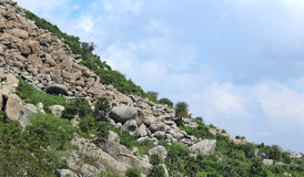 Landscape with hill of  boulder stones. Mountainsides and sky background photo Stock Photography