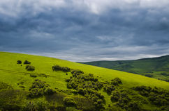 Landscape of hills with dark clouds Royalty Free Stock Photo