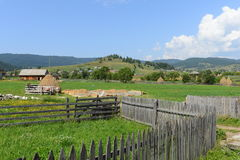 Landscape with hills and fence in Bilbor. Bilbor in Hungarian Bélbor, in German Belbern is a village in Harghita County, Transylvania, Romania. The settlement Royalty Free Stock Photos