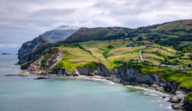 Landscape with hills, fields and abrupt coast. Stock Photo