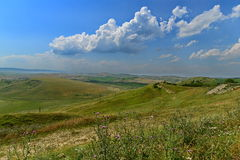 Landscape with hills and grass. Royalty Free Stock Photos