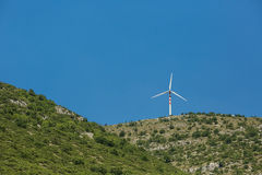 Landscape with hills and wind turbines Royalty Free Stock Image