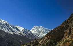 Landscape in Himalayas, Annapurna range, Nepal. Mountain inspirational landscape in Himalayas, Annapurna range, Nepal. Mountain ridge with ice and snow over royalty free stock photos