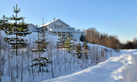 Landscape of the holiday home is surrounded by trees in winter s Royalty Free Stock Image
