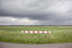 Landscape in holland with rain clouds an traffic sign Royalty Free Stock Photo