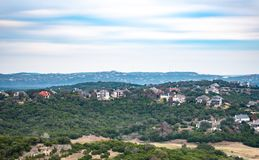 Landscape of homes nestled in trees, built into hill country of Austin, Texas royalty free stock photo