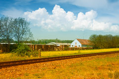 Landscape with house and rail Stock Photos