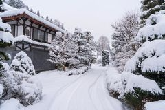 Landscape of house and trees in snow with wintry frosty day royalty free stock image