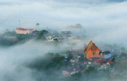 Landscape of houses on the mountain on foggy day Royalty Free Stock Image