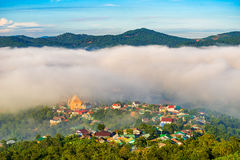Landscape of houses on the mountain on foggy day Stock Photos