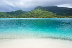 Landscape Huahine island from white sand beach Royalty Free Stock Photography