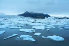 Landscape with ice floes in the glacial lake Fjallsarlon, Icelan Royalty Free Stock Photography