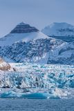 Landscape ice nature of the glacier mountains of Spitsbergen Longyearbyen Svalbard arctic ocean winter polar day sunset sky. Norway landscape ice nature of the stock photos